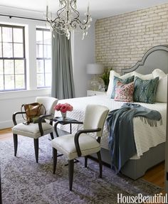 Exposed brick, crystal chandelier and a tufted headboard? This may be the ultimate feminine retreat.