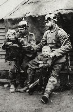 German soldiers on outpost duty share their food with Belgian orphans. Antwerp, 1915.