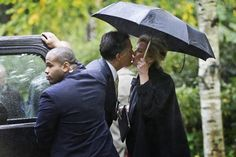 APTOPIX Romney Republican presidential candidate and former Massachusetts Gov. Mitt Romney kisses wife Ann as he leaves the Church of Jesus Christ of Latter-day Saints in Belmont, Mass. Pictures Of The Week, Cool Pictures, 2012 Election, Kissing In The Rain, Latter Day Saints, Presidential Candidates, Abc News, Love And Marriage, Ny Times