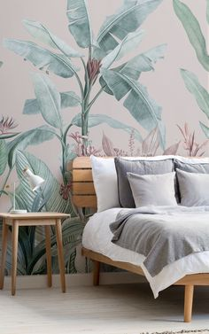 Give your space the dreamy transformation it deserves with Redouté Pink as your new tropical accent-wall. This whimsical wallpaper mural mixes a light dusty pink background with coral, purple, and minty green tones in the trees and leaves. The result is wall design that feels like an island paradise. The plant illustrations are botanical art pieces from the 1800s, which we have given a modern-meets-vintage makeover. Paradise Wallpaper, World Map Wallpaper, Tropical Wallpaper, Forest Wallpaper, Peaceful Bedroom, Dream Bedroom, Japanese Bedroom, Tropical Bedrooms, Art Deco Bedroom