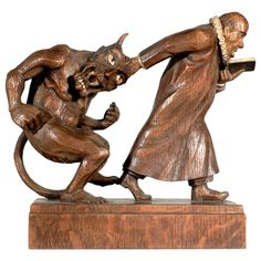 Black Forest Monk and Devil Carving   From a unique collection of antique and modern more folk art at https://www.1stdibs.com/furniture/folk-art/more-folk-art/