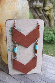 Leather Chevron Necklace with turquoise beads antiqued copper chain. $28.00, via Etsy.