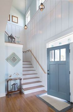 Board and batten foyer. A foyer with board and batten walls painted in