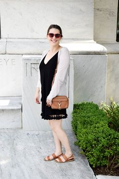 This black tassel dress is perfect for hot summer days. Get the full look on AnExplorersHeart.com