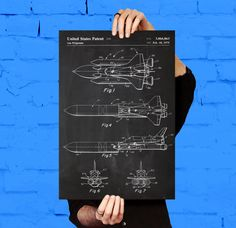 NASA Space Shuttle Print, NASA Space Shuttle Poster, NASA Space Shuttle Patent, Nasa Space Shuttle Blueprint, Nasa Space Shuttle Art by STANLEYprintHOUSE  3.00 USD  We use only top quality archival inks and heavyweight matte fine art papers and high end printers to produce a stunning quality print that's made to last.  Any of these posters will make a great affordable gift, or tie any room together.  Please choose between different sizes and col ..  https://www.etsy.com/ca/listing/..