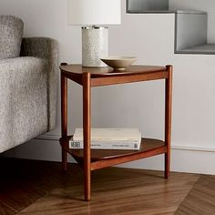 Retro Tripod Side Table #westelm: It's always good to mix up the shapes of your furniture, accessories and decor in your waiting room. It will feel much more balanced and inviting.