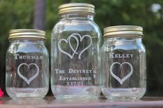 This is a 3 piece mason jar sand ceremony set personalized with your names and the special date of your wedding. All lettering is done by laser engraving and is permanent. The font used in this set is called Rustic This set comes with: 1 Quart 2 pints lids twine If you need a different amount of pouring vases be sure to click on the link below to see my section of sand ceremony set: https://www.etsy.com/shop/EngravingByT?section_id=11161198&ref=shopsection_leftnav_3 If you would like to ...
