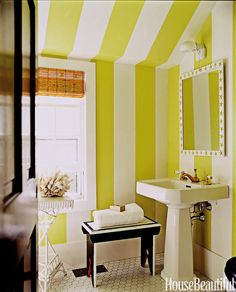 "Designer Leslie Klotz created big, bold stripes in a Hamptons cottage bathroom with Apple Green and Decorator's White, both by Benjamin Moore. ""Since I love bright colors and wacky patterns, my compromise in small spaces is a linear pattern in vivid colors,"" Klotz says. ""I have striped so many rooms that I think my pals wonder if I spent time in prison and can't get the motif out of my brain.""   - HouseBeautiful.com"