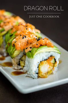 Dragon Roll Sushi. You'll Need: sushi rice, cucumber, avocado, lemon, nori, shrimp tempura, tobiko (flying fish rose), unagi (eel, opt.) For topping - spicy mayo (mayo + Sriracha), unagi sauce (soy sauce, mirin, sugar, and sake), and black sesame seeds.