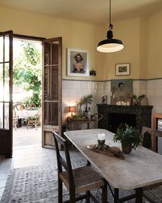Kitchen dining space with yellow walls in a boho home on Mallorca The bohemian home of Dusty Deco founders on. Decor, Home Kitchens, House Design, Sweet Home, Interior, Yellow Walls, Dining Room Decor, Home Decor, House Interior