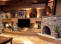 Stacked stone corner fireplace design for an upscale custom home entertainment center media wall design by DAGR Design