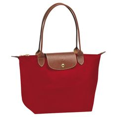 My red Le Pliage Lonchamp and my blue Le Pliage Longchamp... Elegant always! Simple is better, and can wear them all the time!