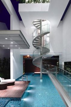 A spiral staircase down to a beautiful swimming pool. A dream pool for sure! #ingroundpools