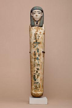 Shabti of Senbi  Period: Middle Kingdom Dynasty: Dynasty 12 Date: ca. 1981–1802 B.C. Geography: Egypt, Middle Egypt, Meir (Mir) Medium: Wood, paint