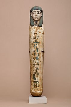 Shabti of Senbi  Period: Middle Kingdom Dynasty: Dynasty 12 Date: ca. 1981–1802 B.C. Geography: Egypt, Middle Egypt, Meir (Mir) Medium: Wood, paint
