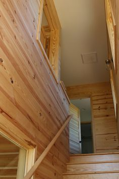 """All interior rooms have pine tongue and groove paneling - """"D"""" grade southern yellow pine (wanted to show the knots). Modern mountain farmhouse, cabin, corten steel metal roofing, cedar siding, pine paneling interior, marvin windows and doors, casement windows, glulam beams, tongue and groove floor decking, tongue and groove roof deck, SIPs panels, stained concrete floor, open floor plan, loft, alternating tread stair, architectural design, architect, mountain views, front porch, venacular design Stained Concrete, Concrete Floors, Casement Windows, Windows And Doors, Design Architect, Architecture Design, Steel Metal, Metal Roof, Sips Panels"""