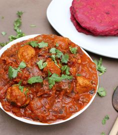 Turkey Ball Curry - What I have done is add coriander powder to the turkey balls before they were baked, and to the curry, and topped it all off with cilantro. Tomato paste and coconut milk help marry all the spices and what you end up with is a curry with depth and flavor – that pairs well with rice or beet roti!