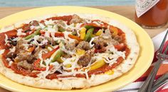 Get the kids to help make these fun, yummy lil' pizzas with pita or flatbread. A fast and fun weekday meal.
