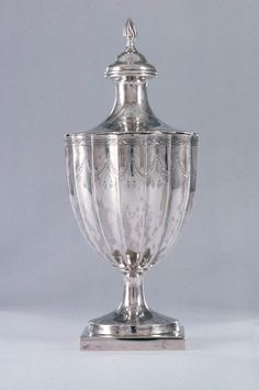 """Silver Sugar urn - about 1790 - Paul Revere, Jr. (American, 1734–1818) - Made in Boston, Massachusetts - Dimensions: Overall: 8.3cm (3 1/4in.) Other (Overall): 10.6cm (4 3/16in.) Overall: 25.7 cm (10 1/8 in.) -  This unmarked urn was made for Revere's family. It is probably the """"1 silver sugar pot 14 oz"""" recorded in the 1818 probate inventory of Revere's estate."""
