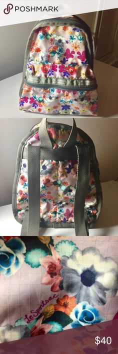 """LeSportsac Small Floral Backpack Small LeSportsac backpack - Floral design - 15"""" x 12.5"""" x 7.5"""" in. - adjustable straps - 1 outside pocket & 1 small zipper interior pocket - nylon with canvas trip - very gently used/great condition - perfect bag for concerts/festivals/day trips/hiking etc. LeSportsac Bags Backpacks"""