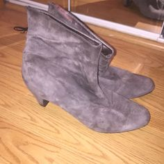 Sam Edelman Grey Suede Booties EUC only worn 3-4 times. Grey suede with ruching on the back and black bow. Silver leather on the inside and very comfortable cushioned insole. 1 3/4 in heel. Only selling because I just don't wear them as much and trying to clean out my closet. I'm also more of a true 8.5 and these are an 8. Any questions let me know :) Sam Edelman Shoes Ankle Boots & Booties