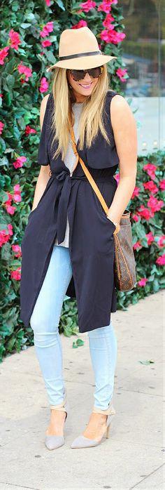 Spring / Summer - street chic style - beach look - camel fedora + white sleeveless top + black long vest + denim skinnies + nude stilettos