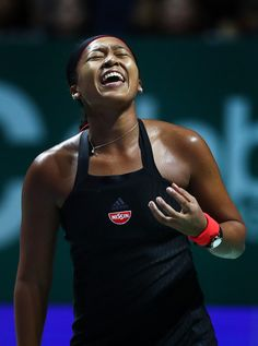 Naomi Osaka Photos - Naomi Osaka of Japan reacts to a missed shot in her women's singles match against Angelique Kerber of Germany during day 4 of the BNP Paribas WTA Finals Singapore presented by SC Global at Singapore Sports Hub on October 24, 2018 in Singapore. - BNP Paribas WTA Finals Singapore Presented By SC Global - Day 4 Osaka, Us Open, Australian Open, Angelique Kerber, Strong Character, Japan, Tennis Players, Athletes, Singapore