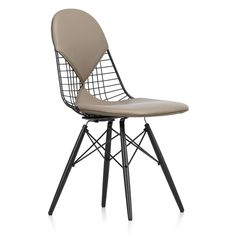 The Eames DKW-2 Wire Chair from Vitra is a variation on the organically shaped one piece seat shell, but with its technical black powder coated wire construction this version gives the chair a light transparency.