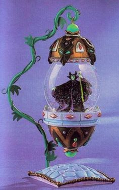Scan from the Disney Catalog. Sleeping Beauty Description: This Maleficent globe can be detached from its metal stand and used as an ornam. Disney Love, Disney Magic, Disney Art, Water Globes, Snow Globes, Disney Snowglobes, Sleeping Beauty Maleficent, I Love Snow, Disney Rooms