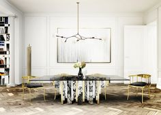 If you have a large dining room, then you have plenty of space to let your imagination work. No one will be indifferent with the impressive Heritage Dining Table by Boca do Lobo. The golden details from the table match perfectly with the four classic yet modern Nº11 Dining Chairs. It is truly convenient for any house design. The golden details are set with the Brubeck Floor Lamp, at the left corner, close to the Coleccionista Bookcase, a dream to any book lover.