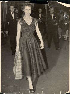 Queen's Diamond Jubilee: the Queen leaves the Wyndham Theatre in a blue lace dress with sailor collar detailing, after seeing 'The Boyfriend' on a warm summer's night, in August 1954.