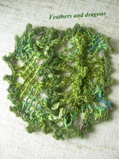 I used a cord with buttonholes, made with the knitting fork as a stopping cord in sprang. I also used picot knitting in this one,