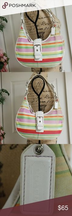 Coach Bag Elegant colorful Coach bag.  One large pocket on the back of purse.   Three pockets on the inside. Two open pockets and one with zipper.   Minimal wear  Very good condition. Coach Bags