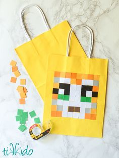 I needed a gift bag for the kids to hold their loot at the Stampy Minecraft birthday party, and came up with this incredibly easy craft to add Stampy Cat to a plain yellow gift bag.