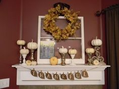 Seasonal decor: Thanksgiving - I like the idea of using candle holders to hold little pumpkins of different size! Mine will be more orange and brown but still a great concept.