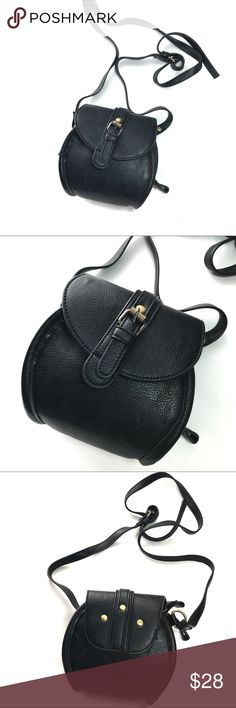 """NWOT Mini black faux leather crossbody purse Cute mini black faux leather crossbody purse. Excellent condition. Perfect purse for going out or casual wear! Gold buttons on back of purse & gold strap attachment. Strap is adjustable.   Length = 6"""" Width = 6"""" Bags Crossbody Bags"""