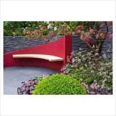 Sloping garden wall and curved seat, balanced look of modern seating within nature
