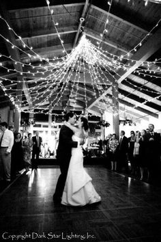 Capture beautiful memories with unique lighting designs as the backdrop with Dark Star's high-end lighting services for weddings.  Lit by Dark Star Lighting, Inc.
