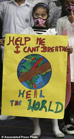 Holding a poster, a girl wears wearing a face mask during a protest against air pollution . Save Our Earth, Save The Planet, Slogans On Global Warming, Science Projects, School Projects, Poster On Pollution, Save Earth Posters, Advertisement Examples, Calligraphy Doodles