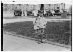 Lewis Hine: 7 year old ferris tiny newsie who did not know enough to make change for investigator.