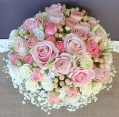Divine pink and ivory bouquet with a pop of peach.