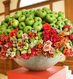 I like the idea of infusing green apples with the gardenias, for one large centerpiece.