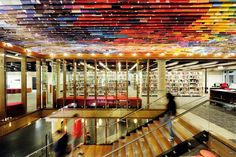 At QUT Kelvin Grove Library, a ceiling made of hundreds of old book covers adds drama to the staircase