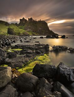 Dunluce Castle (from Irish: Dún Libhse) is a now-ruined medieval castle in Northern Ireland. ~by Gary McParland