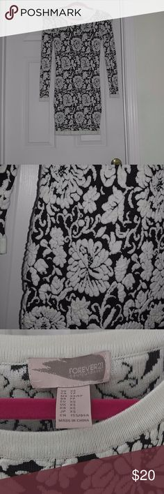 Forever 21Floral Black and Cream sweater dress Excellent Condition Worn once. It is a knitted texture. Forever 21 Dresses