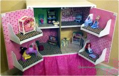"DIY Dollhouse with Repurposed Furniture - garage sale TV stand painted and ""dolled"" up into a fabulous doll house!"