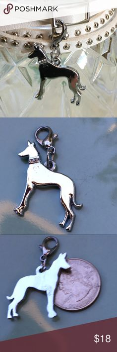 """Bling💎 Ridgeback, Doberman silver clip charm Shiny Silver colored charm with clip and  💎'gemstone' collar .🐕🐕🐾🐾🐾Choose: Sterling silver plated snake chain - 20"""" long 🐾🐾🐾 OR 🐾 White, brown or Black strap leather with silver colored metal accents and buckle. Measures approx 36"""" long when un - wound. Fun addition for a goth look or just to wear with jeans.  IF you only want the clip charm, choose CHARM ONLY and bid $10. Silhouette looks like - Ridgeback, Doberman pincer, great dane…"""