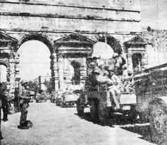 Sgt. Jimmy Declay, Apache, stands guard at the gateway to Rome as the U.S. Army enters the city.