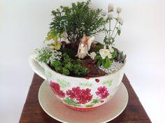 Fairy garden in a giant teacup planter