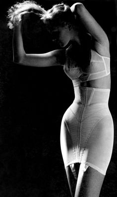 "Lillian Bassman 1950.   From YZC ""My mother came to fashionable and womanly maturity in the 1950's.  My father, 9 years older, hated very much the tight undergarments he would feel beneath her clothing.  Neither one ever changed their mind..."""